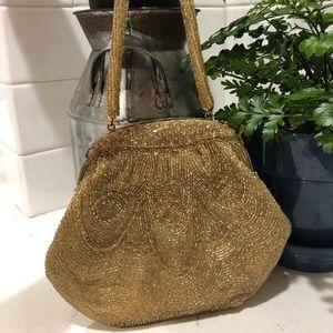 Gold beaded Waldorg purse. vintage